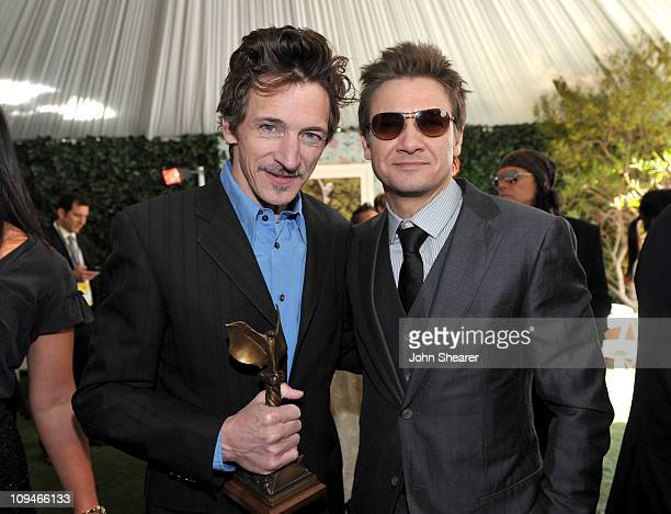 John Hawkes winner of the Best Supporting Male award for 'Winter's Bone' and actor Jeremy Renner in the Piaget Lounge at the 2011 Film Independent...