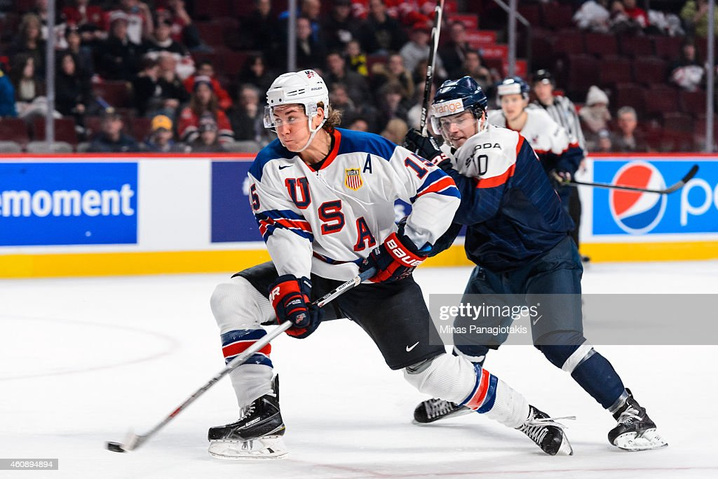 John Hayden #15 of Team United States backhands the puck with Martin Reway #10 of Team Slovakia following close behind during the 2015 IIHF World Junior Hockey Championship game at the Bell Centre on December 29, 2014 in Montreal, Quebec, Canada. Team United States defeated Team Slovakia 3-0.