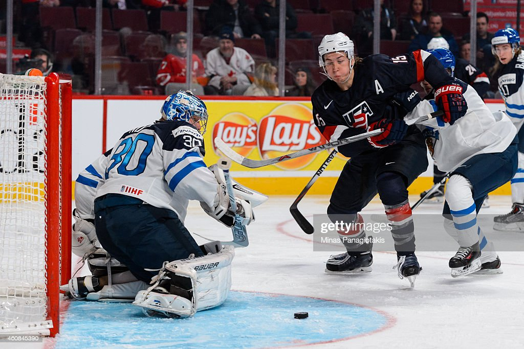 John Hayden #15 of Team United States tries to capitalize on a rebound left by goaltender Ville Husso #30 of Team Finland during the 2015 IIHF World Junior Hockey Championship game at the Bell Centre on December 26, 2014 in Montreal, Quebec, Canada. Team United States defeated Team Finland 2-1 in a shootout.