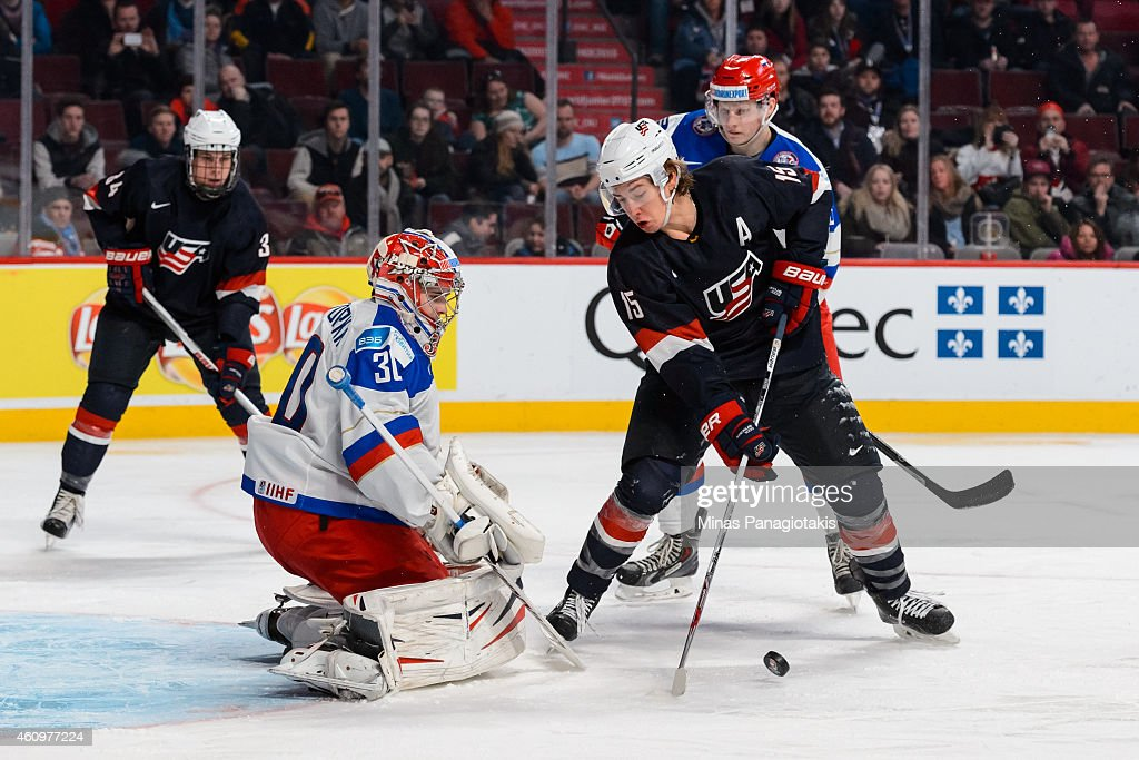 John Hayden #15 of Team United States tries to take a shot on Igor Shesterkin #30 of Team Russia in a quarterfinal round during the 2015 IIHF World Junior Hockey Championships at the Bell Centre on January 2, 2015 in Montreal, Quebec, Canada. Team Russia defeated Team United States 3-2.