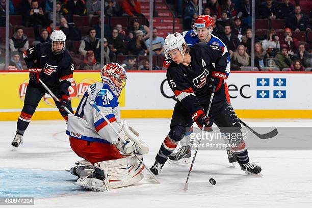 John Hayden of Team United States tries to take a shot on Igor Shesterkin of Team Russia in a quarterfinal round during the 2015 IIHF World Junior...