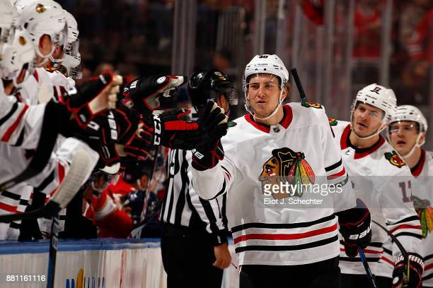 SUNRISE FL NOVEMBER 25 John Hayden of the Chicago Blackhawks celebrates his goal with teammates during the first period against the Florida Panthers...