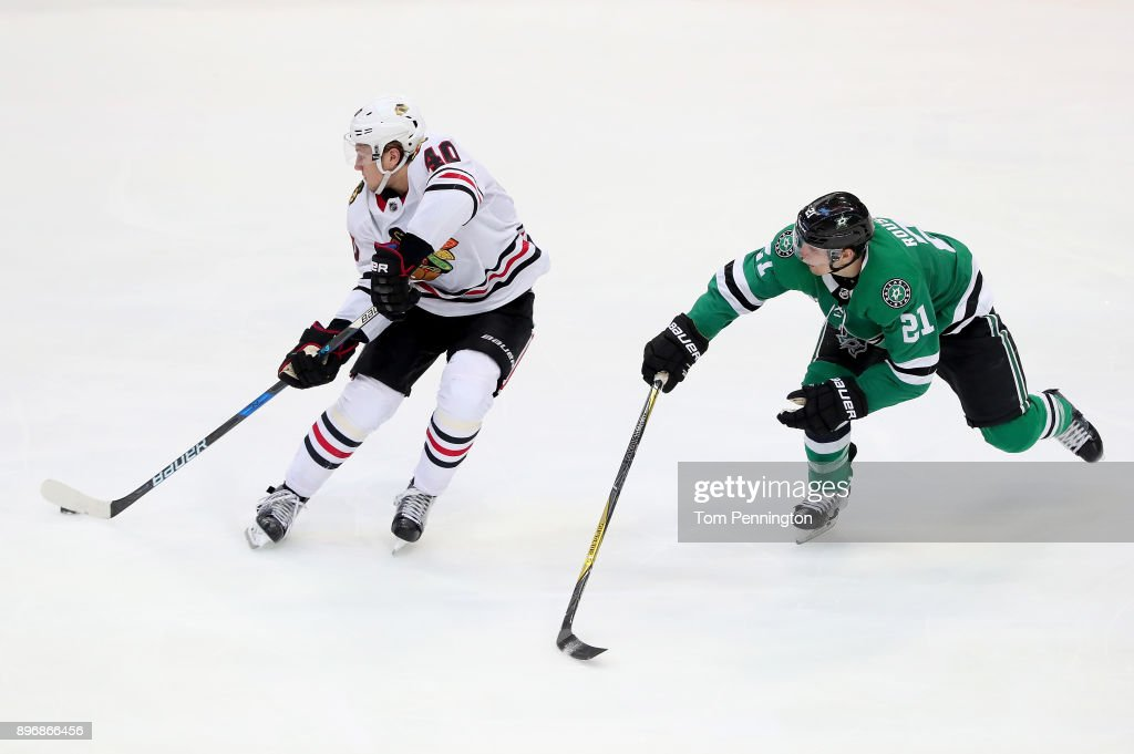 John Hayden #40 of the Chicago Blackhawks controls the puck against Antoine Roussel #21 of the Dallas Stars in the third period at American Airlines Center on December 21, 2017 in Dallas, Texas.