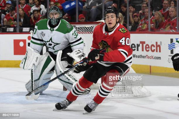 John Hayden of the Chicago Blackhawks skates in front of goalie Ben Bishop of the Dallas Stars in the first period at the United Center on November...