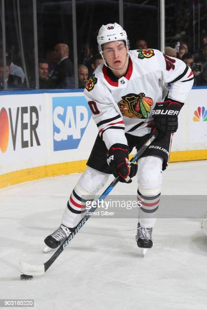 John Hayden of the Chicago Blackhawks skates with the puck against the New York Rangers at Madison Square Garden on January 3 2018 in New York City