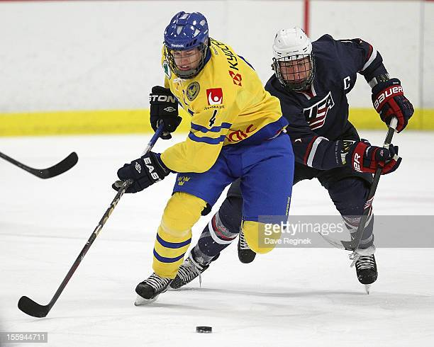 John Hayden of the USA battles for the puck against Robert Hagg of Sweden during the U-18 Four Nations Cup on November 9, 2012 at the Ann Arbor Ice...