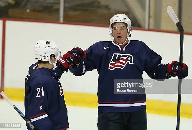 John Hayden of USA Blue celebrates his first period powerplay goal against USA White along with Tyler Motte during the 2014 USA Hockey Junior...
