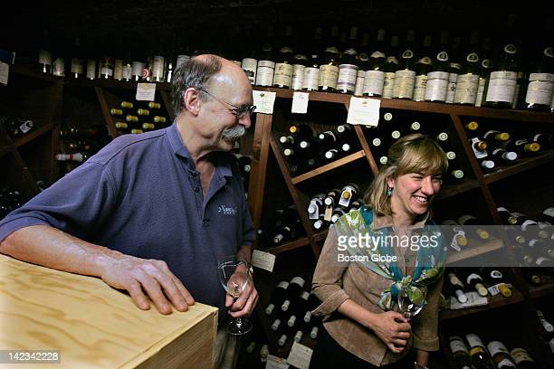 John Hayes left host of a preNantucket Wine Festival dinner gives a tour of his wine cellar to guests including Debbi Otto right the festival's...