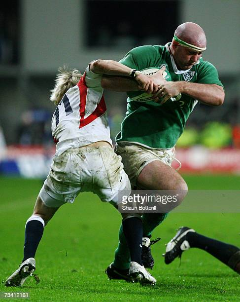 John Hayes of Ireland brushes aside the challenge from David Strettle of England during the RBS Six Nations Championship match between Ireland and...