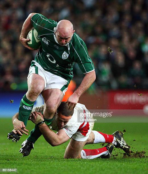 John Hayes of Ireland is tackled by Joe Worsley of England during the RBS Six Nations match between Ireland and England at Croke Park on February 28,...