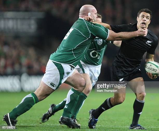 John Hayes of Ireland tackles Dan Carter of New Zealand during the Guinness series match between Ireland and New Zealand at Croke Park on November...