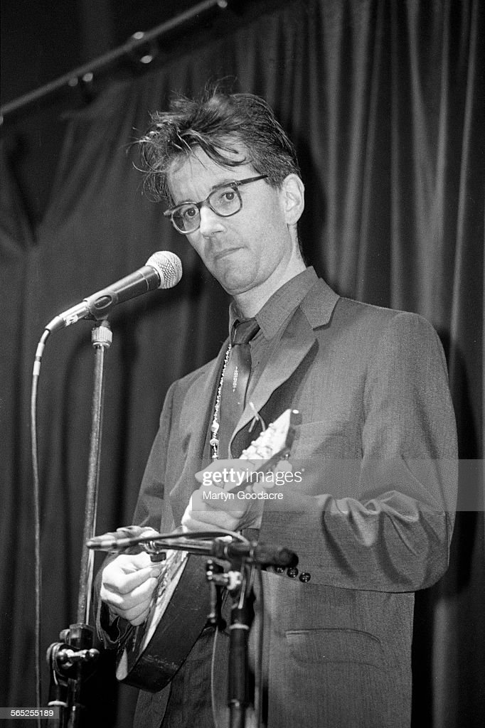 John Hegley performs on stage, Comedy Tent, Glastonbury Festival, United Kingdom, 1990.