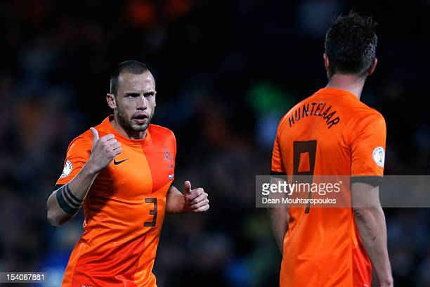 John Heitinga and KlaasJan Huntelaar of Netherlands speak during the FIFA 2014 World Cup Qualifier between Netherlands and Andorra on October 12 2012...