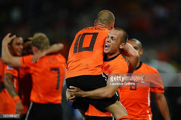 John Heitinga and Wesley Sneijder of the Netherlands celebrate victory during the 2010 FIFA World Cup South Africa Round of Sixteen match between...