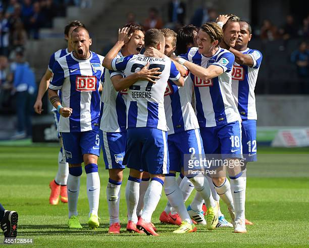 John Heitinga Genki Haraguchi and Peter Niemeyer of Hertha BSC celebrate after scoring the 10 during the Bundesliga match between Hertha BSC and...