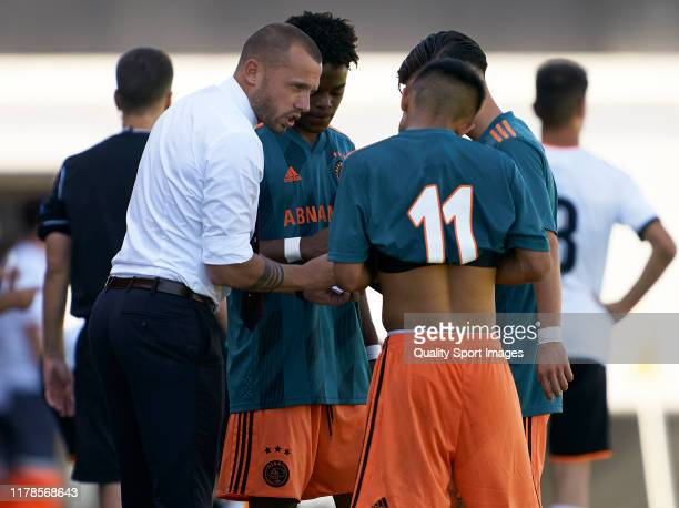John Heitinga Head Coach of Ajax gives instructions during the UEFA Youth League match between Valencia CF and AFC Ajax at Estadio Antonio Puchades...