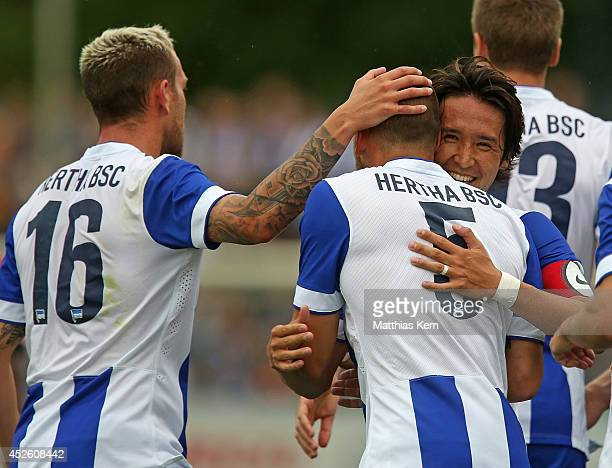 John Heitinga of Berlin jubilates with team mates after scoring the first goal during the pre season friendly match between Hertha BSC and PSV...