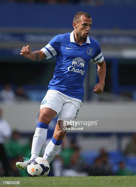 John Heitinga of Everton in action during the pre season friendly match between Everton and Real Betis at at Goodison Park on August 11 2013 in...