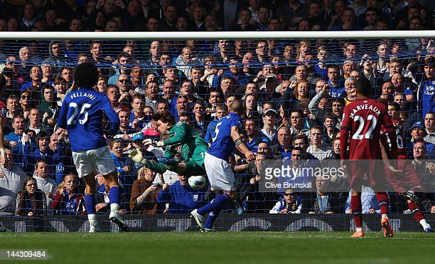 John Heitinga of Everton scores the third goal during the Barclays Premier League match between Everton and Newcastle United at Goodison Park on May...
