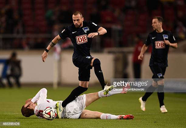 John Heitinga of Hertha BSC challenges Timo Werner of VfB Stuttgart during the Bundesliga match between VfB Stuttgart and Hertha BSC at MercedesBenz...