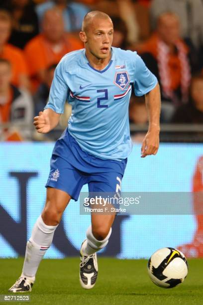 John Heitinga of Holland runs with the ball during the International friendly match between Holland and Australia at the Phillips Stadium on...
