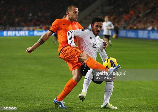 John Heitinga of Netherlands and Ilkay Guendogan of Germany compete for the ball during the International Friendly match between Netherlands and...
