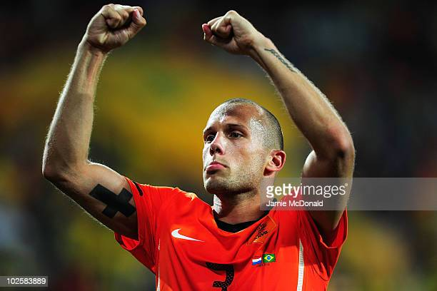 John Heitinga of the Netherlands celebrates victory following the 2010 FIFA World Cup South Africa Quarter Final match between Netherlands and Brazil...
