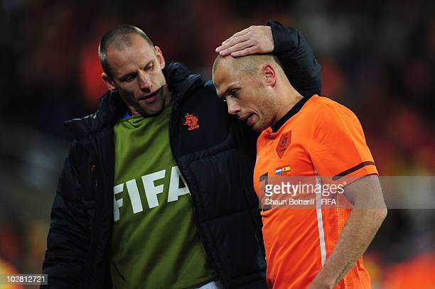 John Heitinga of the Netherlands is consoled after a red card during the 2010 FIFA World Cup South Africa Final match between Netherlands and Spain...