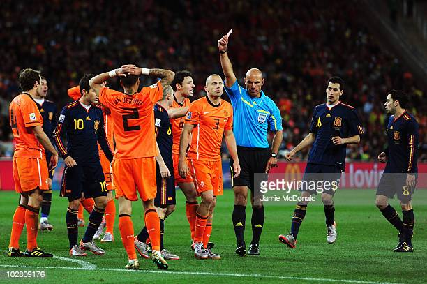 John Heitinga of the Netherlands is shown a second yellow card by referee Howard Webb and is sent off during the 2010 FIFA World Cup South Africa...