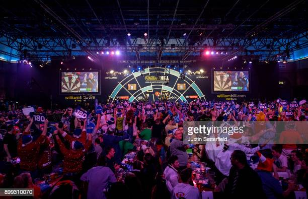 John Henderson in action during his Third Round Match against Rob Cross during the 2018 William Hill PDC World Darts Championships on Day Twelve at...