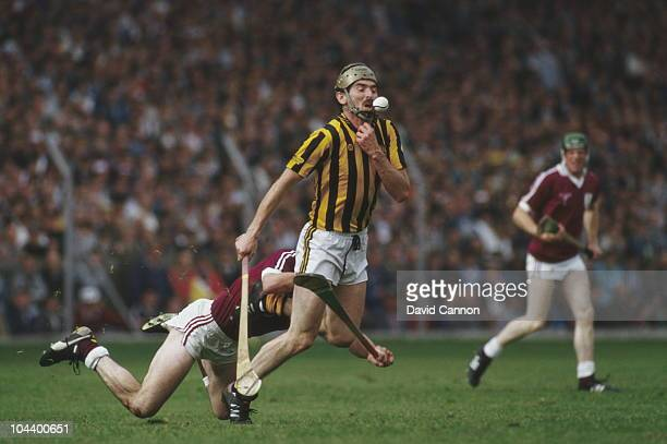 John Henderson of Kilkenny is tackled during the100th All Ireland Senior Hurling Championship final against Galway on 6th September 1987 at Croke...