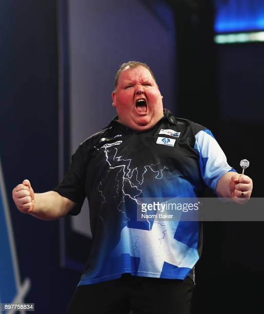 John Henderson of Scotland celebrates after winning the second round match against Daryl Gurney of Northern Ireland on day ten of the 2018 William...