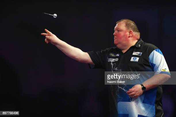 John Henderson of Scotland in action during the second round match against Daryl Gurney of Northern Ireland on day ten of the 2018 William Hill PDC...