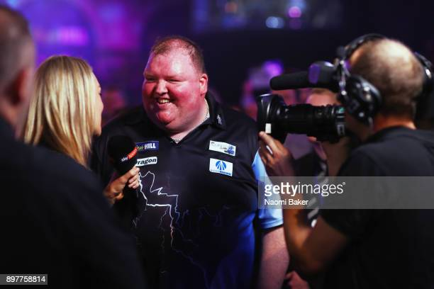 John Henderson of Scotland talks to Sky Sports after winning the second round match against Daryl Gurney of Northern Ireland on day ten of the 2018...