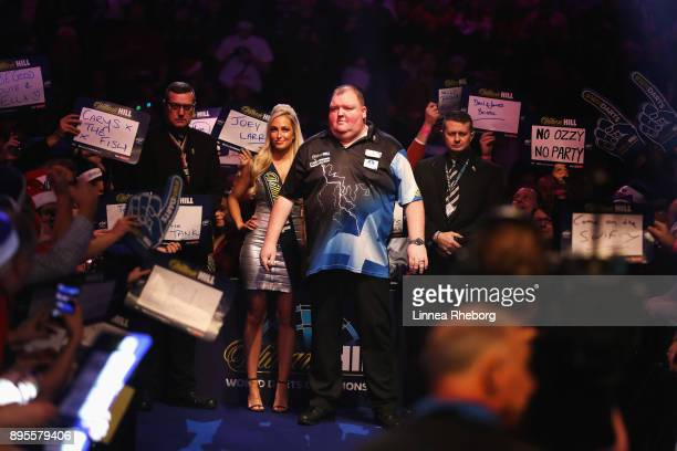 John Henderson of Scotland walks in prior to his first round match against Marko Kantele of Finland on day six of the 2018 William Hill PDC World...