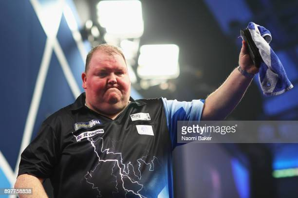 John Henderson of Scotland walks off the stage after winning the second round match against Daryl Gurney of Northern Ireland on day ten of the 2018...
