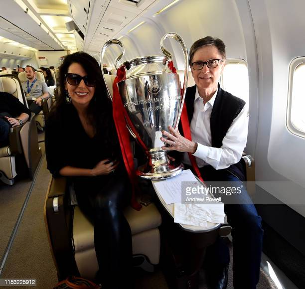 John Henry and Linda Pizzuti Henry owners of Liverpool with the UEFA Champions League trophy during the flight home from winning the UEFA Champions...