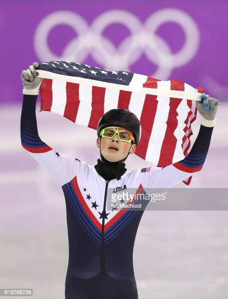 John Henry Krueger of United States celebrates second place in the Men's 1000m Final during the Short Track Speed Skating on day eight of the...