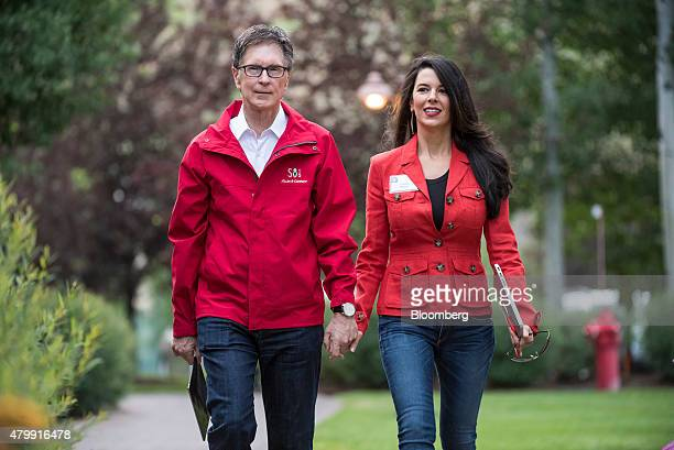 John Henry owner of the Boston Red Sox and wife Linda Henry arrive for a morning session during the Allen Co Media and Technology Conference in Sun...