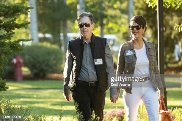 John Henry, principal owner of Liverpool Football Club, the Boston Red Sox and The Boston Globe and co-owner of Roush Fenway Racing, walks with his...