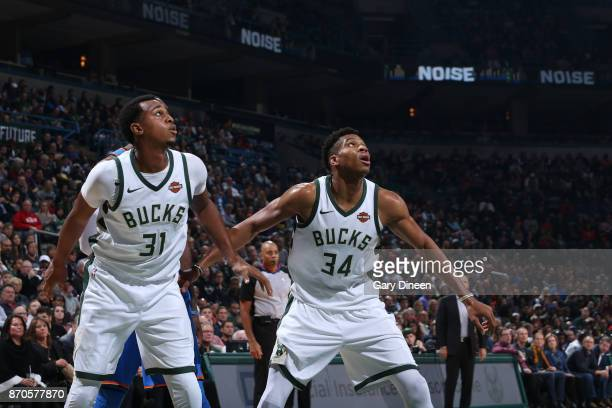 John Henson and Giannis Antetokounmpo of the Milwaukee Bucks defend their positions during the game against the Oklahoma City Thunder on October 31...