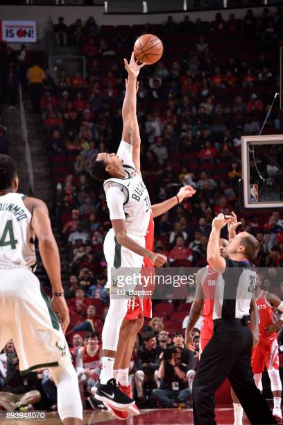 John Henson of the Milwaukee Bucks and Houston Rockets tip off at the start of the game on December 16 2017 at the Toyota Center in Houston Texas...