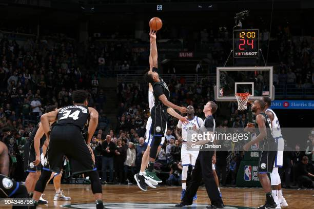 John Henson of the Milwaukee Bucks and Zaza Pachulia of the Golden State Warriors tip off at the beginning of the game on January 12 2018 at the BMO...