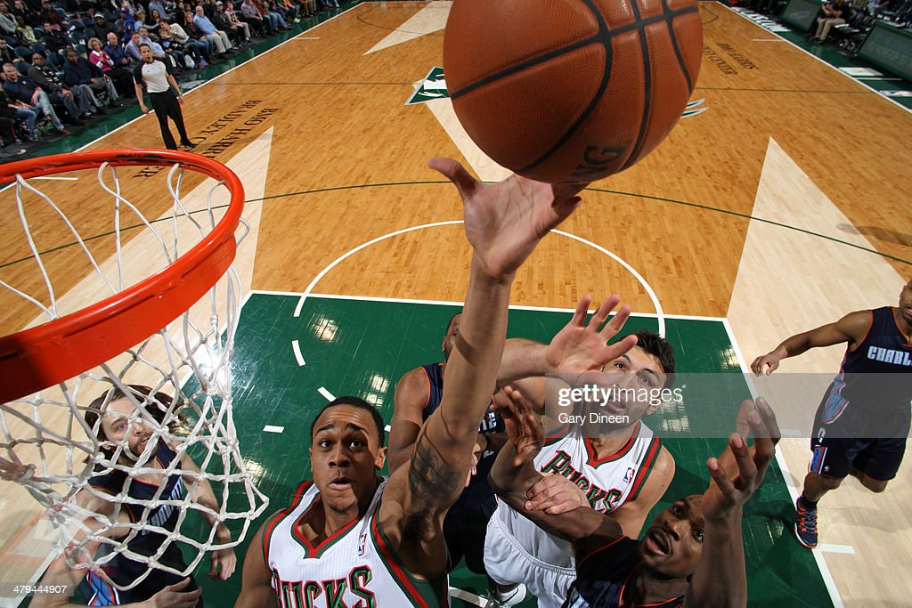 John Henson #31 of the Milwaukee Bucks attempts to make a play for the ball against the Charlotte Bobcats on March 16, 2014 at the BMO Harris Bradley Center in Milwaukee, Wisconsin.