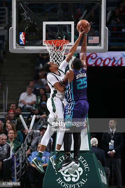 John Henson of the Milwaukee Bucks blocks the shot of Al Jefferson of the Charlotte Hornets on March 26 2016 at the BMO Harris Bradley Center in...