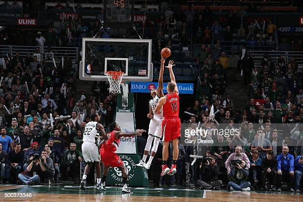 John Henson of the Milwaukee Bucks blocks the shot of Meyers Leonard of the Portland Trail Blazers on December 7 2015 at the BMO Harris Bradley...