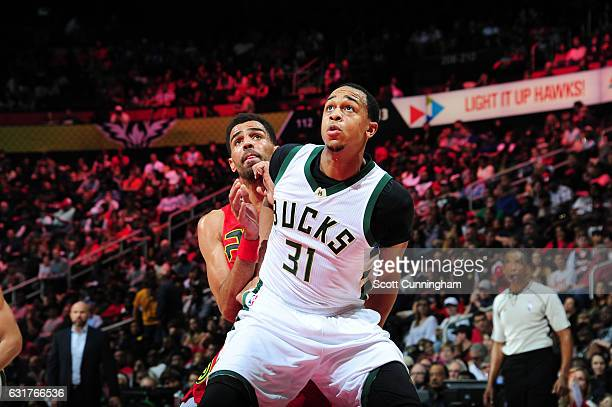 John Henson of the Milwaukee Bucks boxes out during a game against the Atlanta Hawks on January 15 2017 at Philips Arena in Atlanta Georgia NOTE TO...