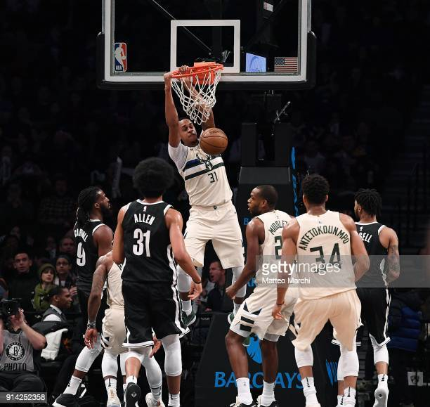 John Henson of the Milwaukee Bucks dunks the ball against Jarrett Allen of the Brooklyn Nets during the game at Barclays Center on February 4 2018 in...