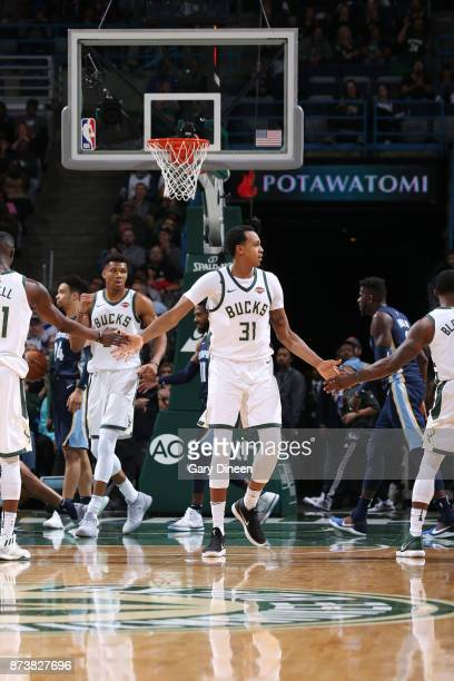 John Henson of the Milwaukee Bucks gives high five to teammates during the game against the Memphis Grizzlies on November 13 2017 at the BMO Harris...