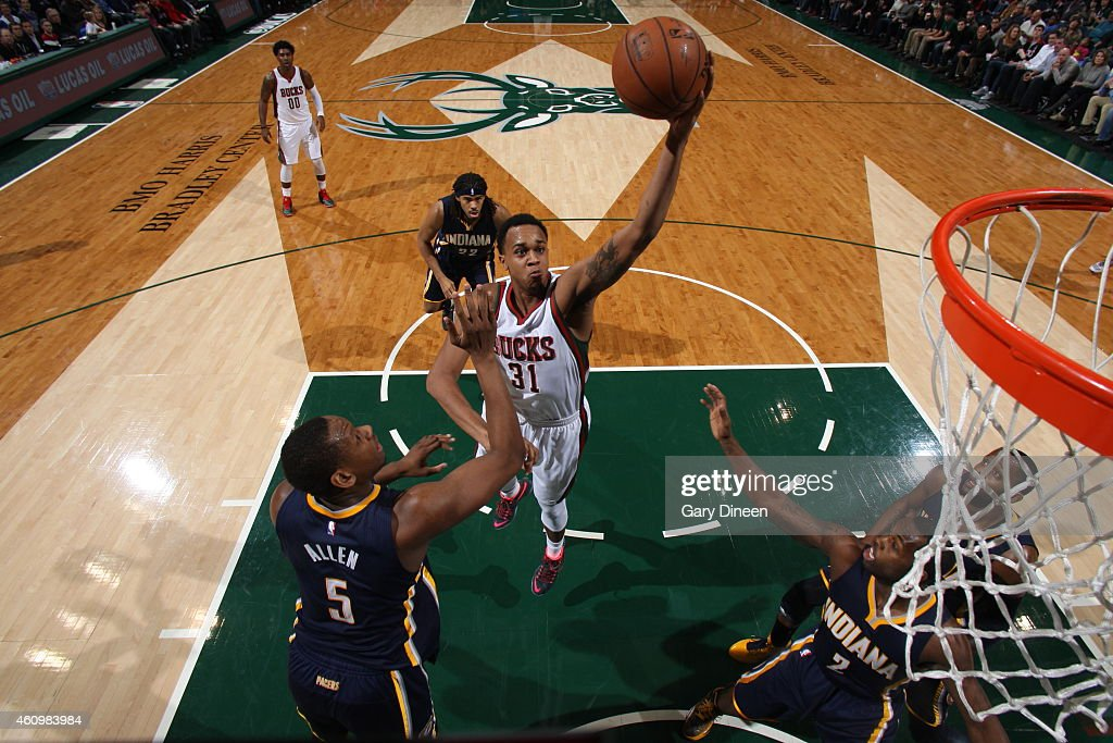 John Henson #31 of the Milwaukee Bucks goes to the basket against the Indiana Pacers on January 2, 2015 at the BMO Harris Bradley Center in Milwaukee, Wisconsin.